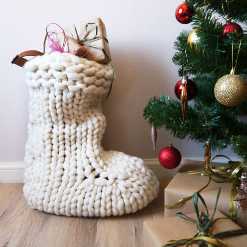 Large knitted stocking by Christmas Tree